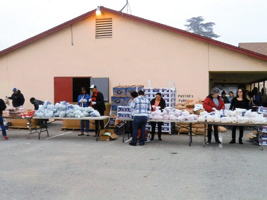 Volunteers work  during a food distribution at St.