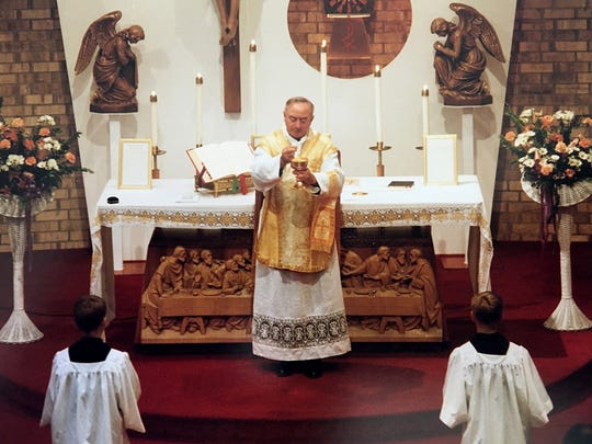 Father Alfred Kunz celebrates Mass in this archival