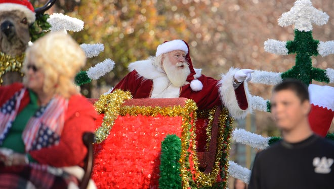 The 68th annual Asheville Holiday Parade in 2014 brings a large crowd to the downtown area of Asheville.