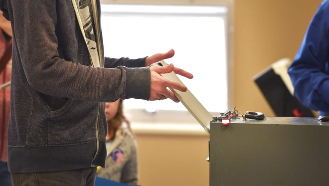 Lance Jeschke places his ballot in the box Tuesday, May 1, for the Mayoral Elections at Oyate Community Center in Sioux Falls.