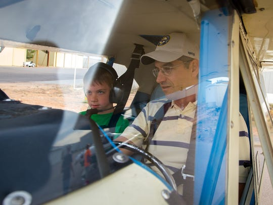 9-year-old Zachary Venable gets flight instruction before takeoff from pilot Chris Iriarte while sitting in Iriarte's 1957 Piper Tri-Pacer at the Las Cruces Airport as part of the Experimental Aircraft Association's Young Eagles event, May 14, 2016. The Young Eagles program, designed to spark interest in piloting aircraft, gives children the chance to fly in small planes and even take the controls for a short period of time.