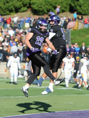 UW-Whitewater running back Drew Patterson (left) scored three touchdowns to help Whitewater cruise to a 48-6 victory over host UW-Eau Claire on Saturday.