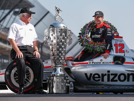 Winner of the102nd running of the Indianapolis 500 Will Power and Roger Penske pose for photos with the Borg-Warner Trophy at Indianapolis Motor Speedway on Monday, May 28, 2018.