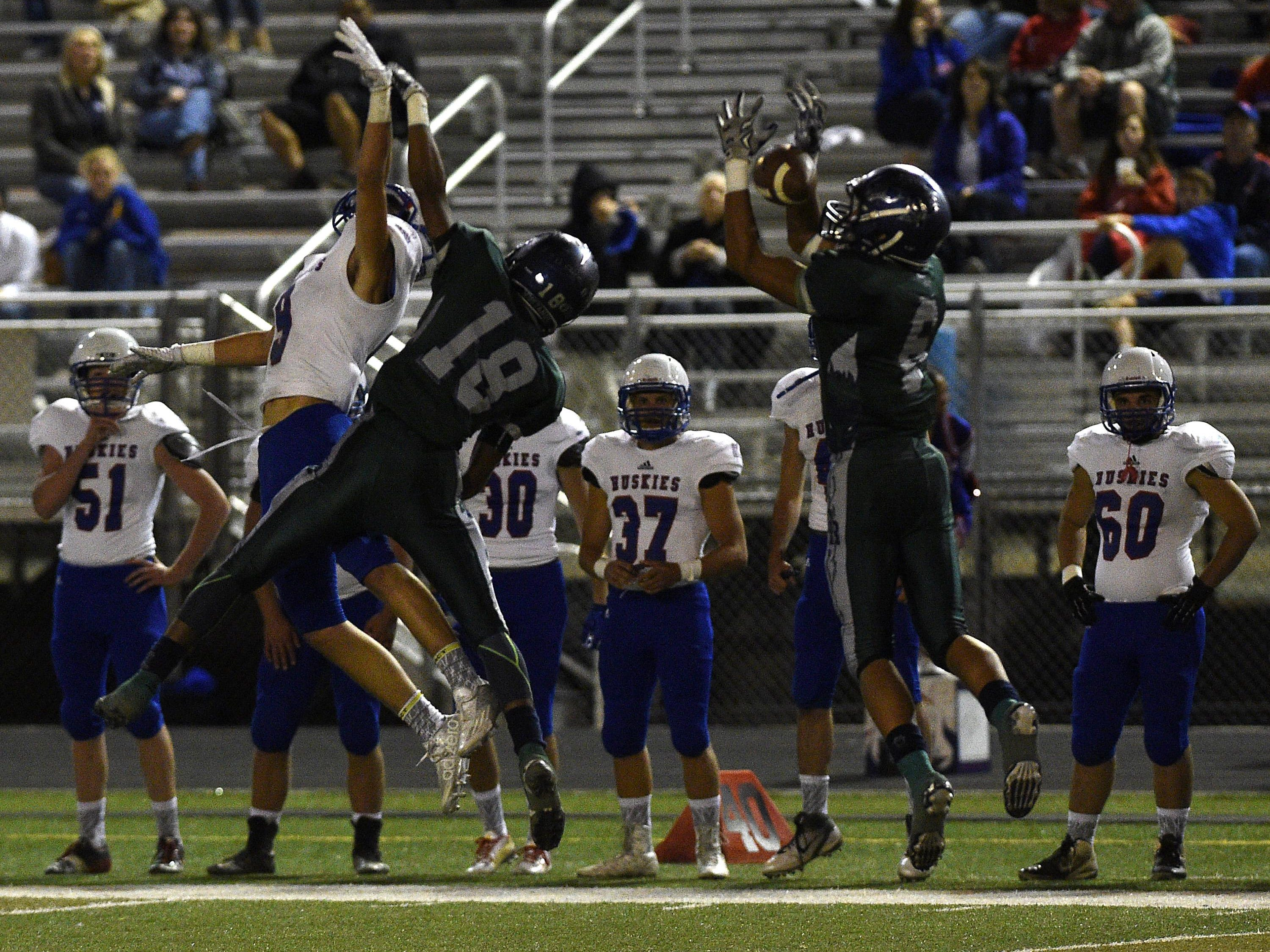 Damonte Ranch's Dru Jacobs (6) intercepts a pass intended for Reno's Will Barnard (9) during their football game on Friday.