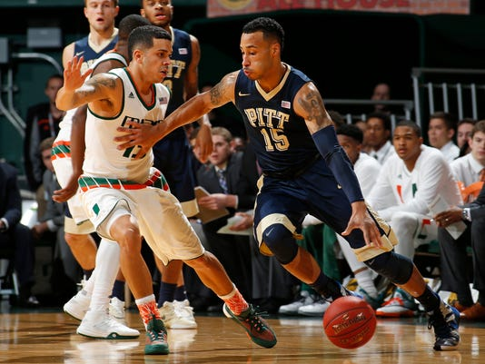 Pittsburgh's Sterling Smith (15) dribbles to the basket against Miami's Angel Rodriguez (13) during the first half of an NCAA college basketball game in Coral Gables, Fla., Tuesday, Feb. 9, 2016. (AP Photo/Joel Auerbach)