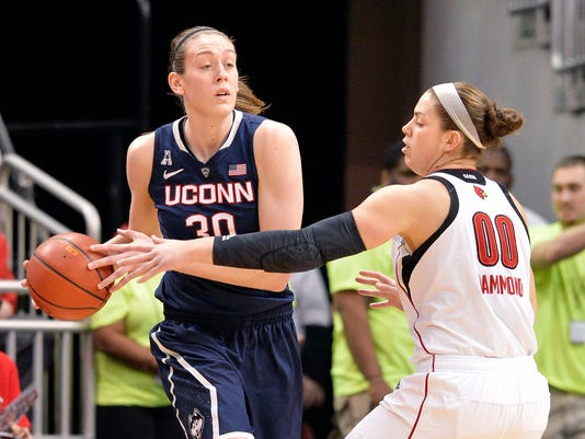 Connecticut's Breanna Stewart, left, looks for help from the defensive pressure of Louisville's Sara Hammond during the first half of an NCAA college basketball game, Monday, March 3, 2014, in Louisville, Ky. (AP Photo/Timothy D. Easley)