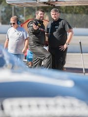 Driver Bubba Pollard, center, chats while testing at Five Flags Speedway in Pensacola on Tuesday, November 22, 2016.  Teams are getting ready for the annual Snowball Derby.