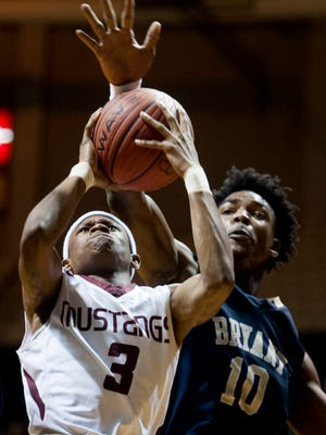 Stanhope Elmore's Kerenski McGhee has his shot blocked by Paul Bryant's Seth Williams at the AHSAA Regional Basketball Championships on the Alabama State University campus in Montgomery, Ala. on Friday February 17, 2017.