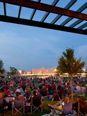 People gather at Shattuck Park in Neenah to watch the