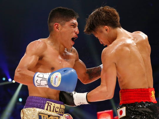 Japanese champion Naoya Inoue, right, sends a right to Ricardo Rodriguez in the second round of their WBO super flyweight boxing world title match in Tokyo, Sunday, May 21, 2017. Inoue knocked out Rodriguez in the third round. (AP Photo/Toru Takahashi)