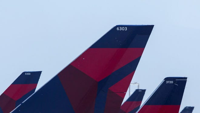 A Delta Air Lines worker was sentenced to 10 years in prison for defrauding the airline with phony vouchers worth $36 million over decades, federal prosecutors announced Friday.