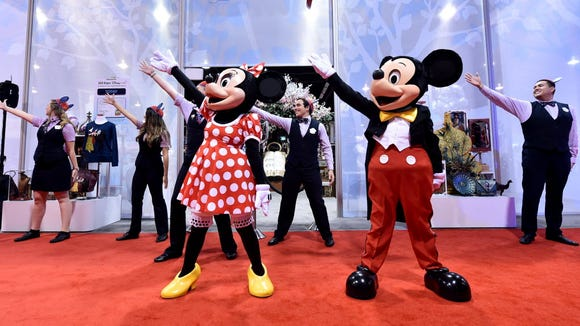 Here's the real deal: Minnie and Mickey open the Disney Store at the D23 Expo on Aug. 14, 2015, in Anaheim, Calif.