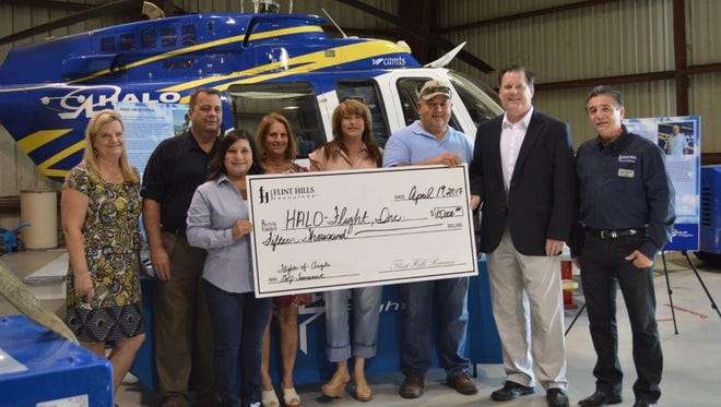 Flint Hills Resources presented a $15,000 check to HALO-Flight on Wednesday April 19, 2017. Patti Young, HALO-Flight Development Director (from left); Larry Webb, FHR Safety Director; Bea Vasquez, FHR Communications Manager; Teri Tinnell and Joanna Mason, Flights of Angels Golf Committee Members; Brandon Molina, FHR; Tom Klassen, HALO-Flight Executive Director; and Andy Saenz, FHR Communications Director attended the presentation.