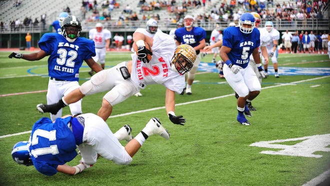 Action from 2009 Paul Robeson All-Star Football Classic. Belleville, Nutley, Bloomfield and Glen Ridge will have representatives playing on the East squad.