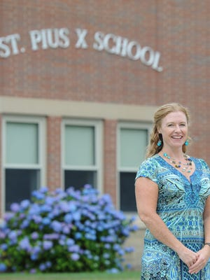 Jennifer Perrault, a second grade teacher at St. Pius X School in South Yarmouth, has received $10,000 as Massachusetts' winner of this year's Sanford Teacher Award.