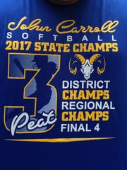 John Carroll Catholic's new practice shirts hail the Golden Rams' run of success. On the back is a hashtag: #NOTAQUITTER.