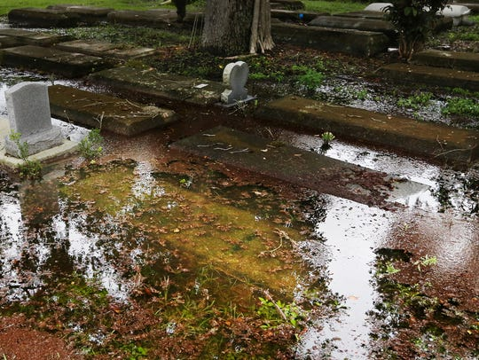 Graves are underwater after a recent rain in the Oakridge