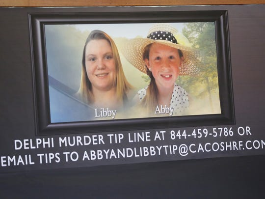 Posters of slain Delphi teens Liberty German and Abigail Williams serve as a backdrop for a press conference for the latest updates on the investigation of the girls deaths Thursday, March 9, 2017, at Carroll County Courthouse in Delphi. The two Delphi teens who were hiking the Delphi Historic Trails on February 13, were found dead a day later.