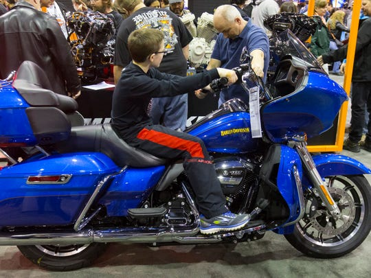 A father and son check out a 2017 Harley-Davidson Road Glide Ultra with a sticker price of $27,599 at the Progressive International Motorcycle Shows at the Donald E. Stephens Convention Center in Rosemont, Ill., in February 2017.
