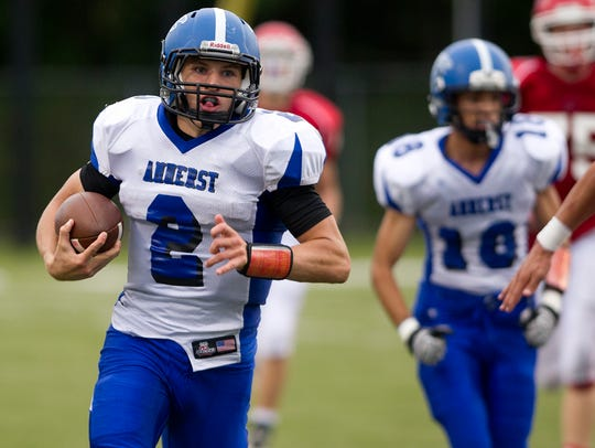 Amherst's Garrett Groshek runs with the ball during