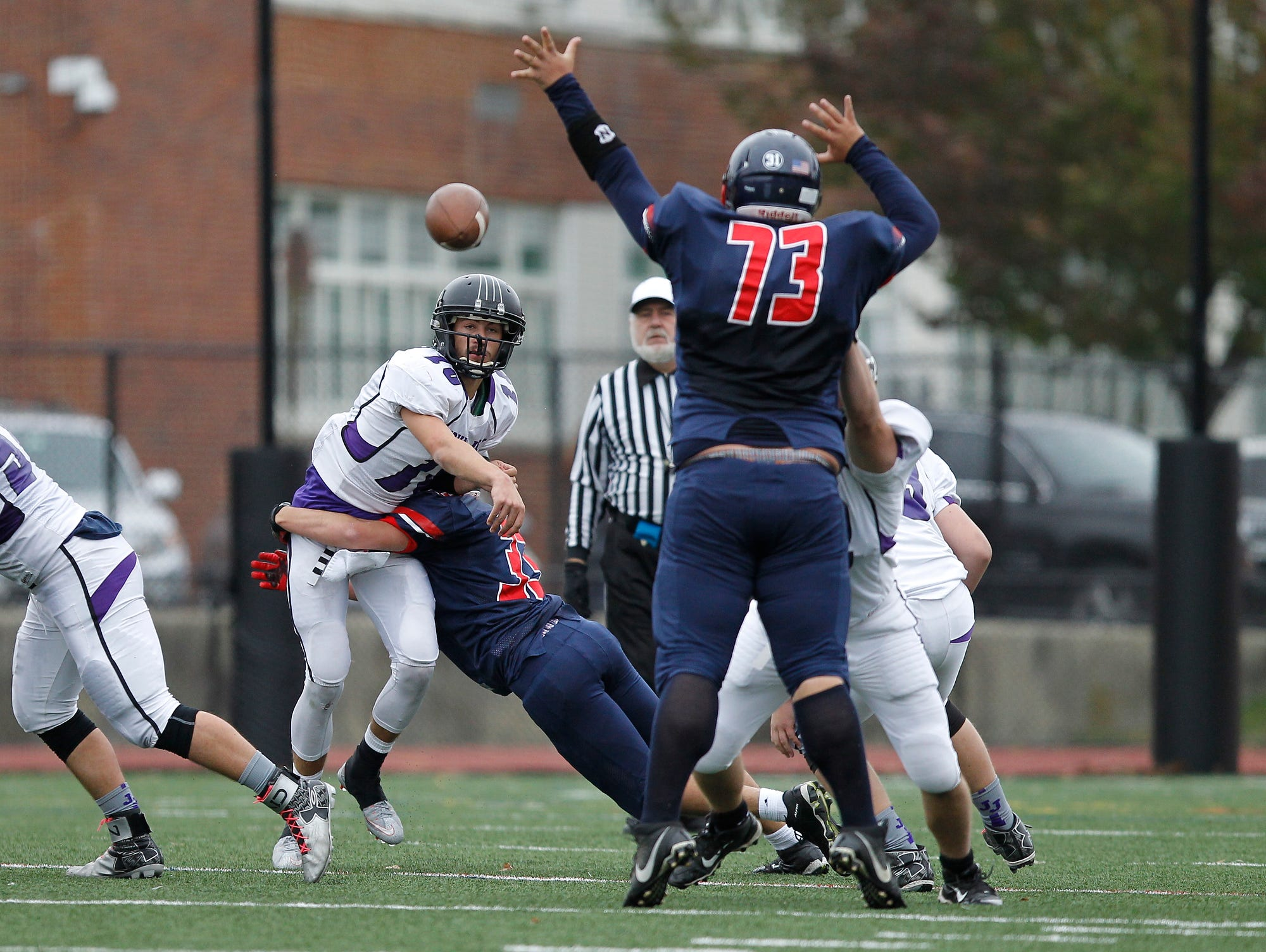 Eastchester's Chris Gorman (73) reaches to block a pass thrown by John Jay quarterback Hunter Keetch (10) during a varsity football game at Eastchester High School on Saturday, Oct. 24, 2015.