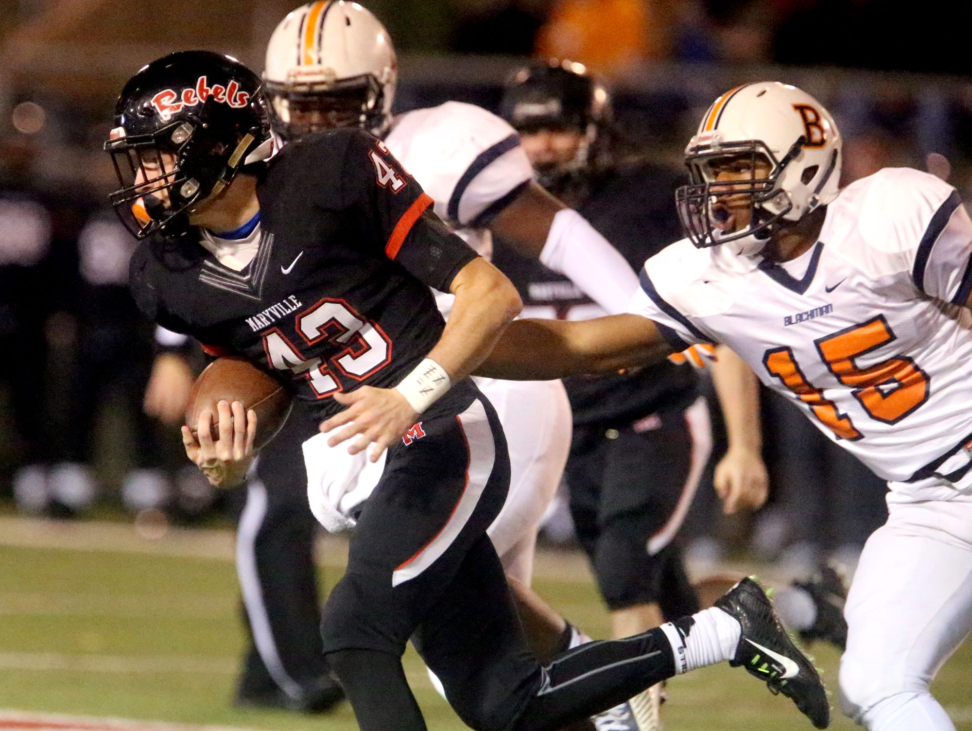 Maryville's Joel Hopkins (43) runs the ball as Blackman's Donnel Bailey (15) tries to stop Hopkins during the quarterfinal game, at Maryville, on Friday, Nov. 20, 2015.