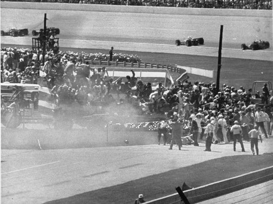 Pace car, driven by car dealer Eldon Palmer, crashing into the photographers stand at the Indianapolis 500 in May 1971.