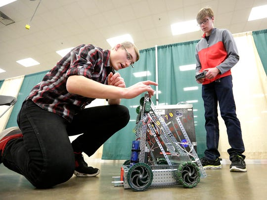 Michael Kurth and Bear McQuitty of Lomira work on their robot Saturday morning at the fourth-annual Ishamon Harris Memorial VEX Robotics Competition Tournament held at the Fond du Lac Fairgrounds.