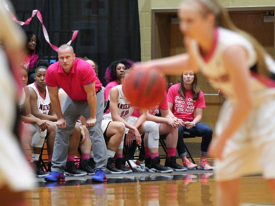 Anderson head coach Jonathon Barbaree watches senior guard Heather Jankowy (1) bring the ball up the court this season. Barbaree's Trojans are 11-2 in road contests.
