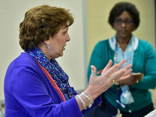 Kim Eaton, director of the Franklin County Day Reporting Center, talks to jury members during the CASHS Youth Court on Wednesday, March 29, 2017. In a new program, students held trials for other students who were charged with school-related offenses.
