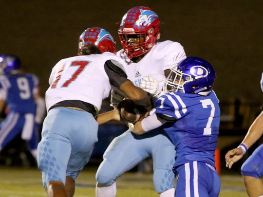 Hirschi's Mar'tez Vrana takes the ball from Daimarqua Foster as he is tackled by a Decatur defender and runs the ball in for a touchdown Friday, Oct. 20, 2017, in Decatur at Eagles Stadium.