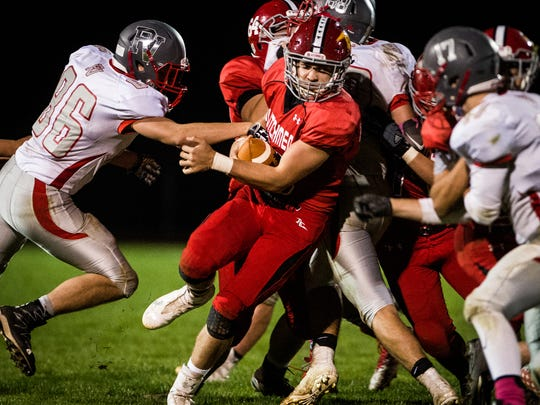 Annville-Cleona's Dominic MacMillan finds running room as Annville-Cleona beat Pequea Valley 22-14 on Friday Oct. 27, 2017.