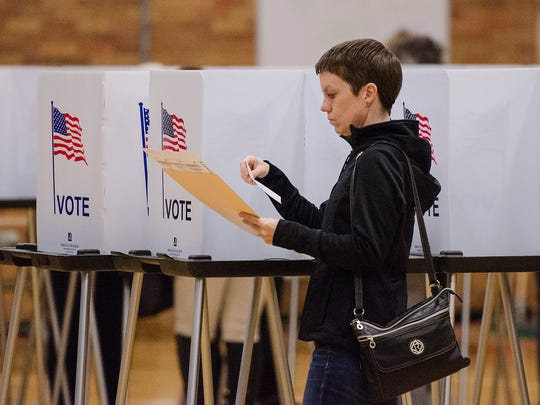 Allison Wright votes at precinct 11, located at Hilbert Middle School in Redford Township.