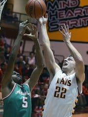 McCutcheon senior Kelden Tyson gets an inside shot