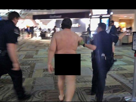 A naked man was found walking around Nashville International
