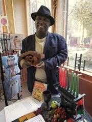 Curtis Kirkland Rivers, owner of Mood Makers Books in Rochester, not only sells books about African-American heritage but also supports arts events in the city.
