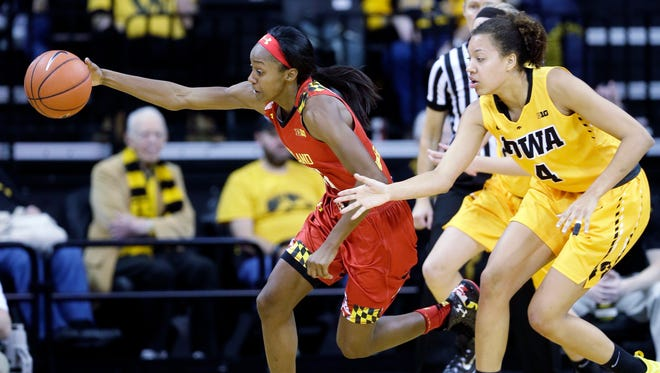 Maryland guard Shatori Walker-Kimbrough runs down a loose ball ahead of Iowa forward Chase Coley, right, during the second half of an NCAA college basketball game, Sunday, Jan. 10, 2016, in Iowa City, Iowa. Maryland won 76-56.