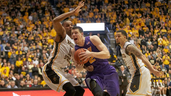 Northern Iowa forward Klint Carlson (2) drives to the basket against Wichita State forward Anton Grady (15) and guard Fred VanVleet (23) during the Panthers' win Saturday.