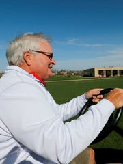 Dennis Albaugh drive a golf car on his 19-hole private