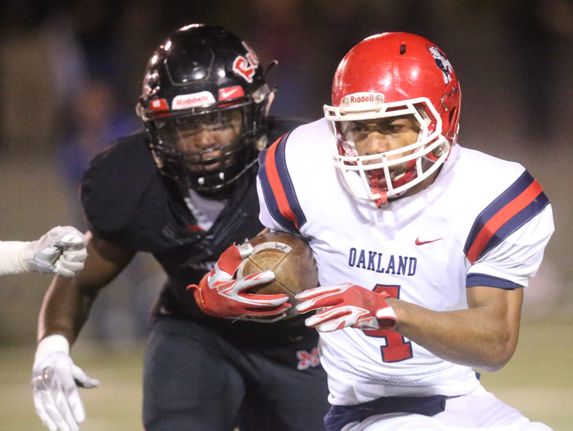 Oakland's Lazarius Patterson runs the ball during the
