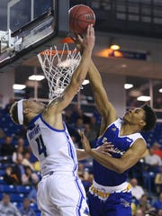 Delaware's Darian Bryant (left) tries to tip the ball