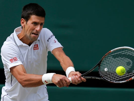 Novak Djokovic of Serbia plays a return to Roger Federer of Switzerland during their men's singles final at the All England Lawn Tennis Championships in Wimbledon, London, Sunday July 6, 2014. (AP Photo/Pavel Golovkin)