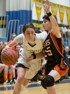 Marlboro's Molly Weiss drives to the hoop past Middletown North's Moe Golembieski. NJSIAA state tournament Central Group IV game between Middletown North and Marlboro.Marlboro, NJ Tuesday, March 01, 2016@DhoodHood