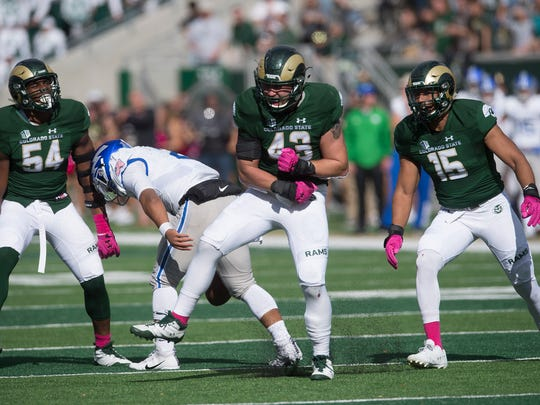 Evan Colorito(43) of CSU celebrates after a sack on Air Force quarterback Arion Worthman(2) during a game at CSU Stadium in Fort Collins, Colorado on Saturday, October 28, 2017.