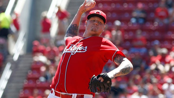 Reds starting pitcher Mat Latos throws a pitch during the first inning Sunday at GABP.