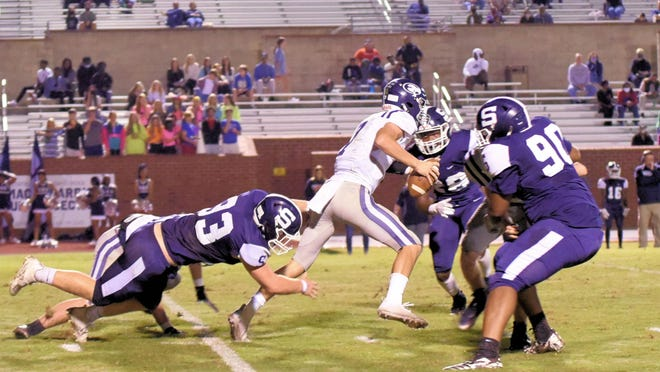 Zach Garcia makes his way past the Blue Devils' defense for a big gain on a quarterback keeper and the first down in the second quarter.