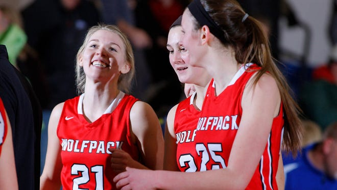 Laingsburg's Sophie Wilsey, left, Michele Hannah, center, and Alex Randall celebrate following their 28-26 win over Bath Friday, Jan. 6, 2017, in Bath, Mich.