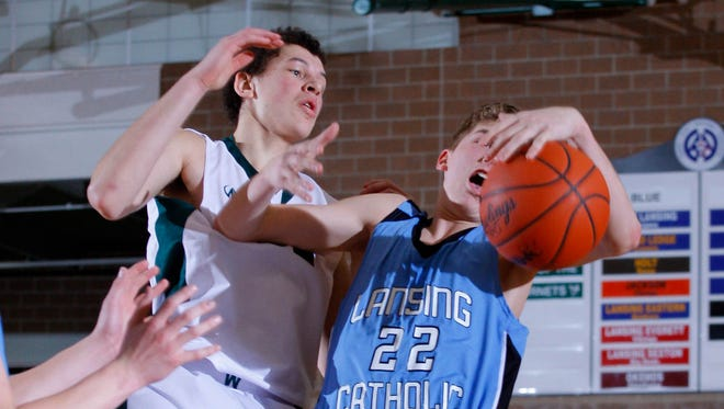 Lansing Catholic's Chuck Plaehn, right, and Williamston's Sean Cobb vie for a rebound during a game last month. Williamston and Lansing Catholic finished as the top two teams in the CAAC White.