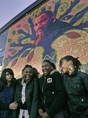Outside the Collége Martin Luther King in Villiers-le-Bel, a Paris suburb, students (from left) Jbilou Myriam, Danielle Duckat, Guirand Precilia, and Amiro Bambo-Fernandes were interviewed in October 2009 by Y-Press reporters about immigration riots in Paris two years earlier.