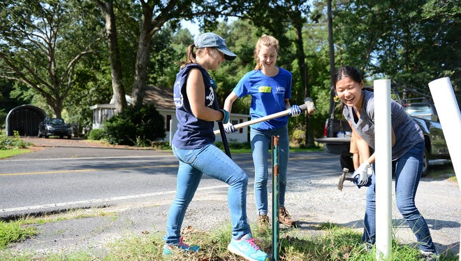 "University of Delaware freshmen Haley McDonald, Abby Humbler and Amanda Plagmann help install a new mailbox along Mount Joy Road in Millsboro on Saturday, Aug. 26 during ""Rock the Block"" sponsored by Sussex County Habitat for Humanity."